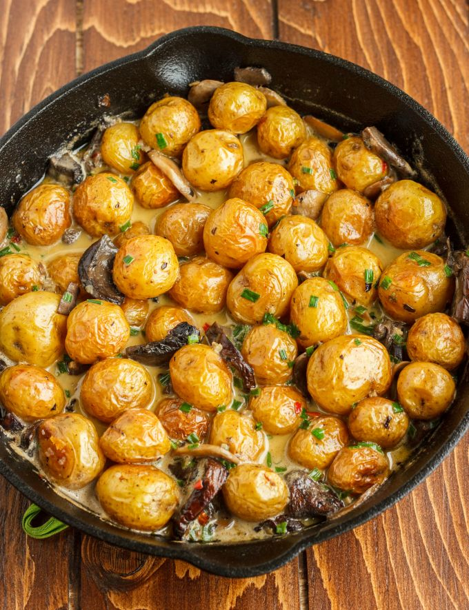 Roasted Baby Potatoes in a Homemade Mushroom Sauce 1  -  veggies, potatoes, portobello and button mushrooms, garlic, balsamic vinegar, broth, chives, white wine, whipping cream, spices.  sounds good.  side dish.   lj