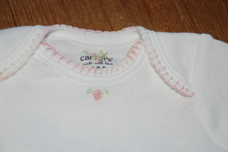I like the blanket stitch on the neck of this onesie from this website:http://www.etsy.com/listing/83675820/infant-boygirl-hand-embroidered-onesie?ref=sr_gallery_2=_search_type=all_includes[0]=tags_exact_search_query=hand+embroider+onesie_page=1_ref=related_facet=