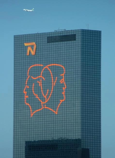 A huge portrait of Queen Beatrix and next King Willem Alexander is placed on the 'Delftse Poort' building in Rotterdam by insurance company Nationale Nederlanden. My daugther works there.