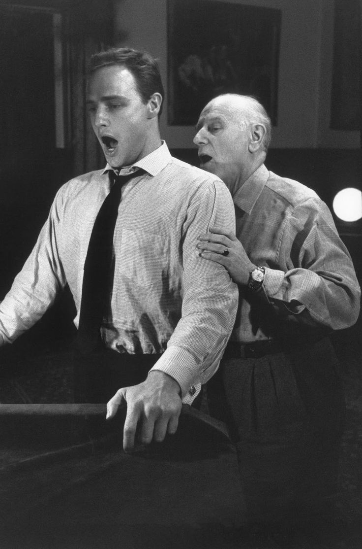 """Marlon Brando practices with his singing coach for his role in """"Guys and Dolls,"""" Goldwyn Studios, 1955, by Bob Willoughby"""