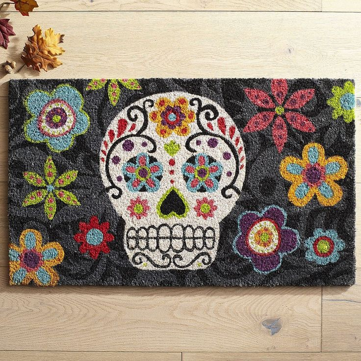 A flower-enhanced skull doesn't seem scary when it's printed on natural coir and backed by foam on our Halloween-inspired doormat.