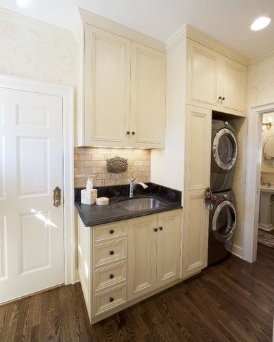 Laundry room does not have to be fancy but would like center isle to fold clothes on and all doorways must be arched.