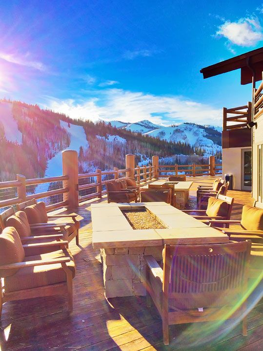 Sit by the fire and watch the skiers at The Stein Eriksen Lodge Hotel and Spa at Deer Valley Resort in Park City, Utah.
