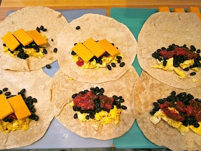 Freezer breakfast burritos from Budget Bytes. {Would substitute bacon bits for beans.}