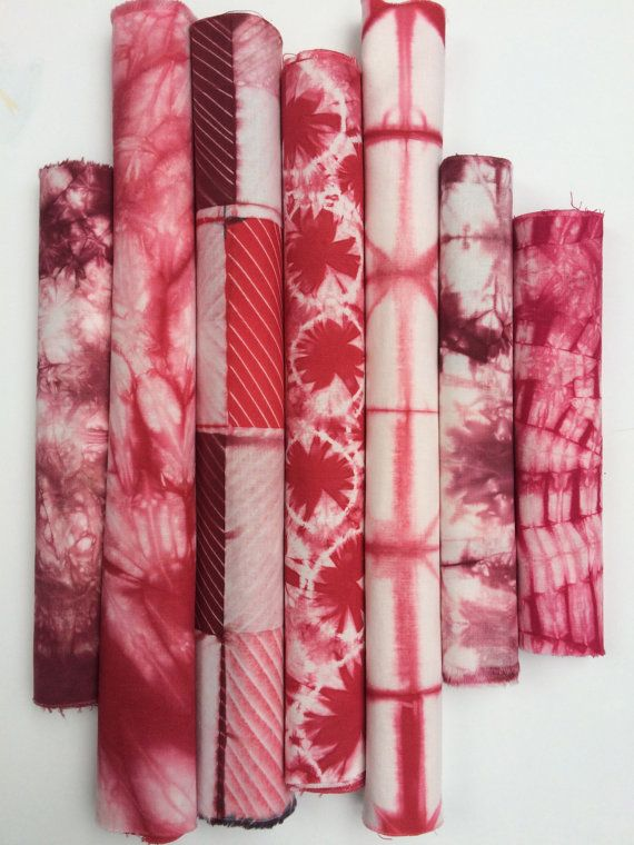 This hand dyed Shibori bundle comes in a palette of cherry and wine reds contrasted against clean, bright white. These fabrics were created with