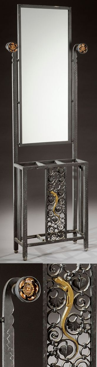 adalbert szabo art deco wrought iron hall mirror and stick stand side supports terminate with floral rosettes base decorated with scrolled foliage