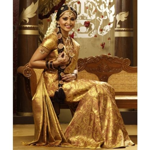 a south Indian wedding braid, with themed accessorizing all the way down. it's coordinated with the sari beautifully.