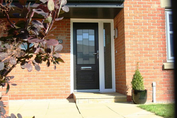 This #Black #Portland #Rockdoor looks fantastic with the white frame and red brick.