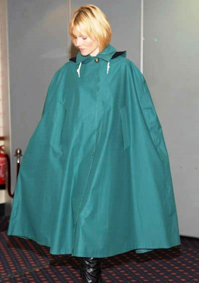 Happy lady in her lovely green cape