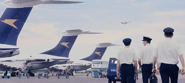 On the tarmac: 1960s pilots make their way to the Vickers VC10s during the 'Aviators' advert
