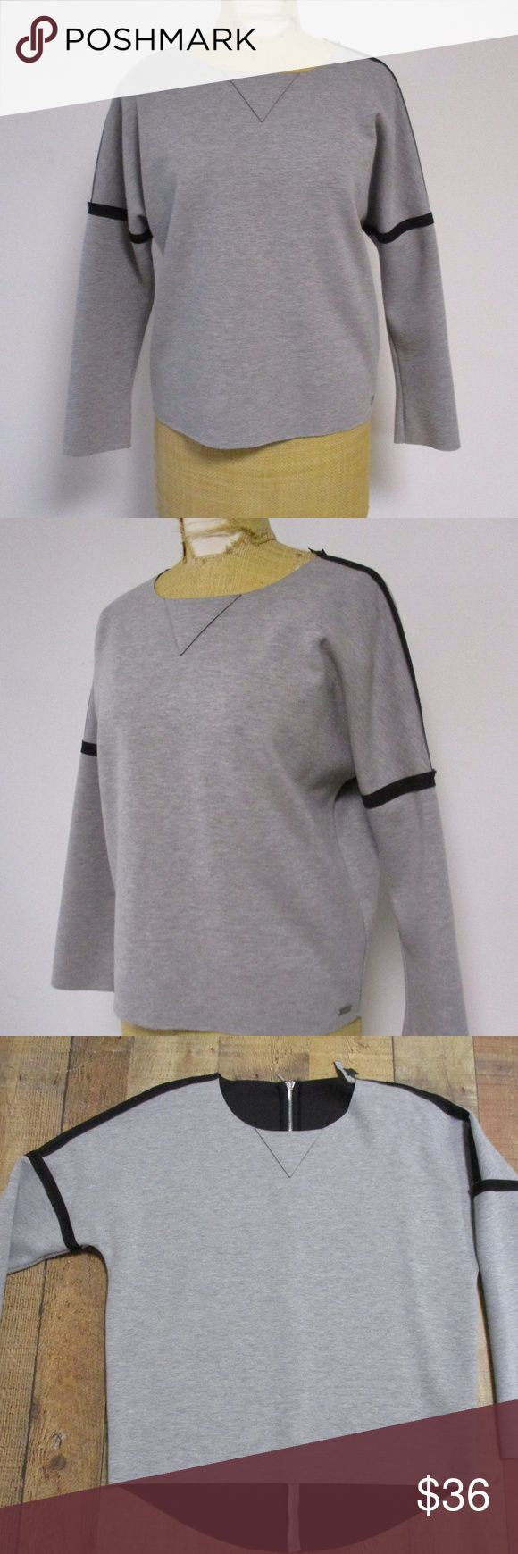 """Armani Exchange Sweatshirt Top Small Description  Beautiful top from Armani Exchange in size small  Gray with black trim  Polyester/cotton face with polyester/spandex back  Machine wash inside out  Loose fit  Exposed zipper in back  Looks like a sweatshirt, but dressier  Armani tag inside needs a stitch to fully attach, otherwise top is in great shape  Bust- 21"""" laid flat to measure Length- 23"""" Sleeves- 24"""" Armani Exchange Tops Sweatshirts & Hoodies"""
