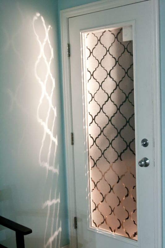 "Contact paper cutouts create a ""frosted"" glass pattern on a door -- could use this on the shower door perhaps?"