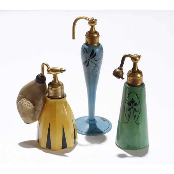 "Three DeVilbiss 1920s Art Deco glass perfume atomizers including motifs in black of dragonfly, floral, and geometric on blue, green and yellow. Tallest; 6 3/8""."