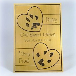 Custom etched plaque for two loved pets. We design and hand etch each piece with your personal prints and inscription. Bluepurple Designs custom etching.