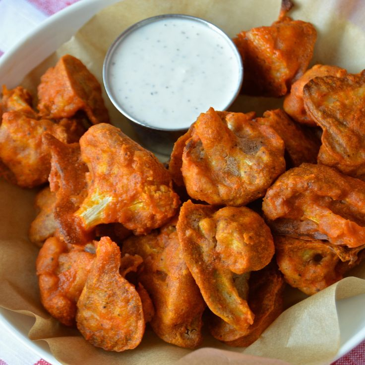 """These delicious cauliflower """"wings"""" are the perfect vegan-friendly vehicle for any dipping sauce. I'm using an easy buffalo sauce here, for a classic flavor."""