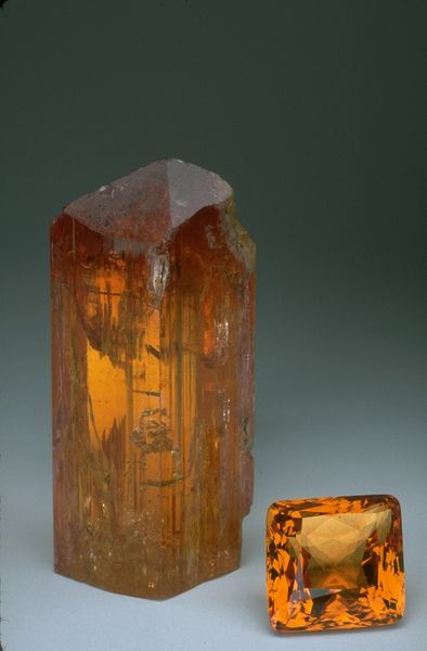 "The highly prized ""imperial topaz"" is an intense golden to reddish-orange color and is found primarily at Ouro Preto, Brazil.  The imperial topaz crystal and gem pictured here weigh 875.4 and 93.6 carats respectively. More commonly, topaz is colorless to pale blue or yellow."