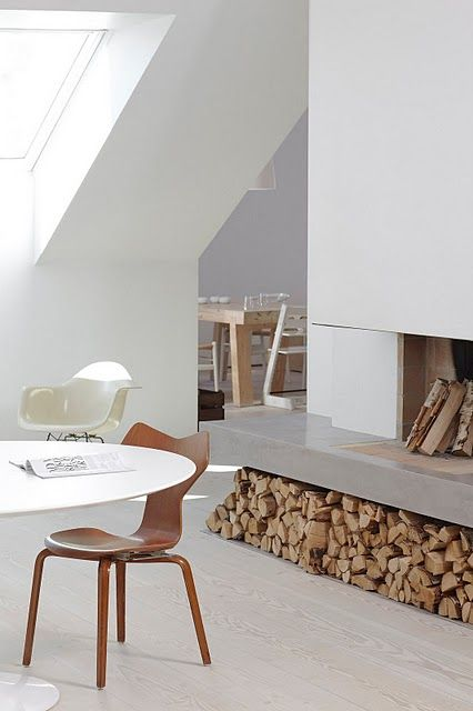 Like this strong, thick fireplace hearth. The wood underneath is more practical than the tall thin stores. In the tall ones, you can only ever choose the next few logs, what if you only want a small one? This system is more useful but would close in sides. And maybe coloured polished concrete?