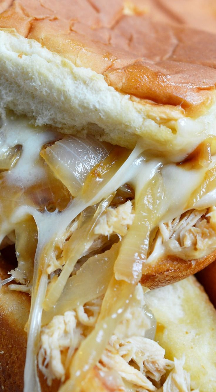 Cheesy French Onion Chicken Sandwiches ~ Soft rolls loaded up with slow cooker chicken, caramelized onions and loads of melt cheese... The ultimate party or game day food and the perfect recipe to feed your hungry crowd!