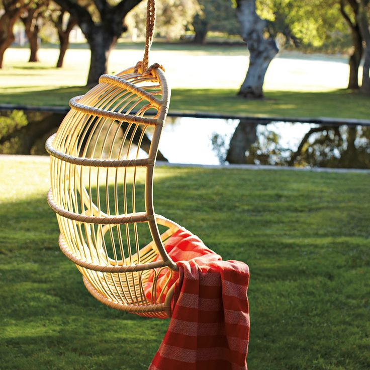 Hanging Rattan Chair | Serena & Lily... Great setting to read a