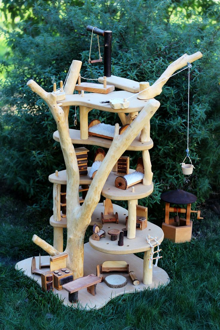 Beautiful and rugged handmade, hand-carved treehouse. to play with,  including pulleys for playful functionality and lots of delightful  furniture!