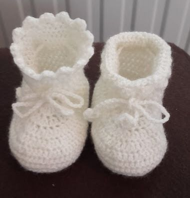 crochet baby booties, in white because mum still don't know the gender  https://web.facebook.com/Jude-Handmade-216830615147075/