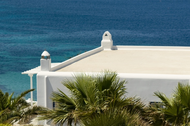 Located on south west part of the resort. The chimney is located on the main building with the White lounge Bar- Mykonos Grand Hotel & Resort
