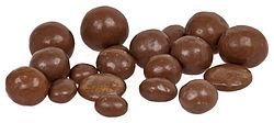 Revels :  hard toffee, raisins, orange creme and coffee creme with a chocolate coating.