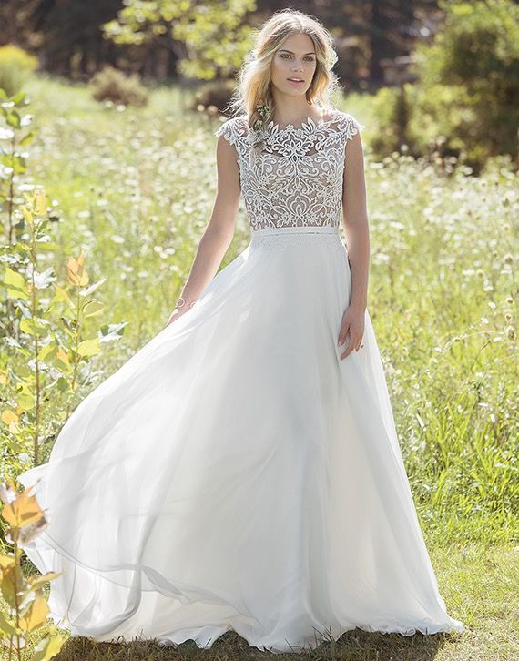 Lillian West 6493 - A modern gown with distinct vintage appeal; a feminine Sabrina neckline is complemented by a sexy keyhole back, contrasting nude lining and ivory lace bodice, cascading lace and light A-line chiffon skirt - The Blushing Bride boutique in Frisco, Texas