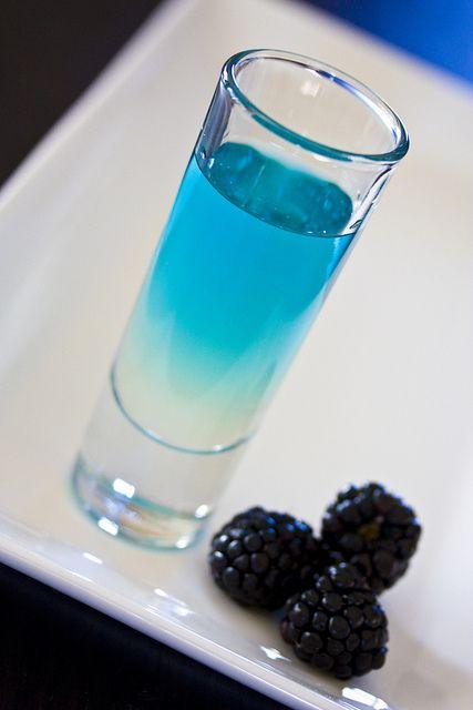Rapture Snozzberry Shot ~ 1 oz Hiram Walker Banana Liqueur, chilled 1 oz DeKuyper Island Punch Pucker, chilled 1/2 oz UV Blue Raspberry vodka, chilled
