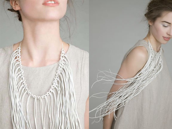 Knotted leather fringe necklace.