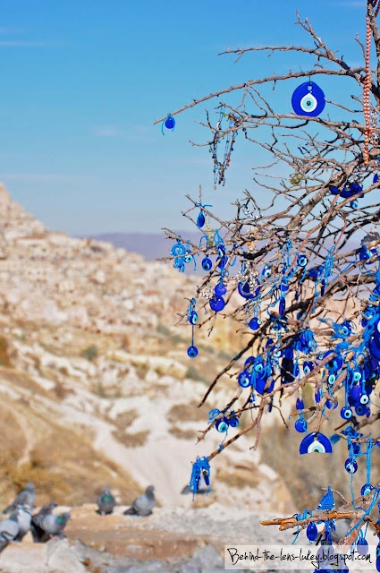 An evil eye tree. Couldn't hurt. Right next to the horseshoe, the prayer flags and the sage. (Kayseri, Turkey).
