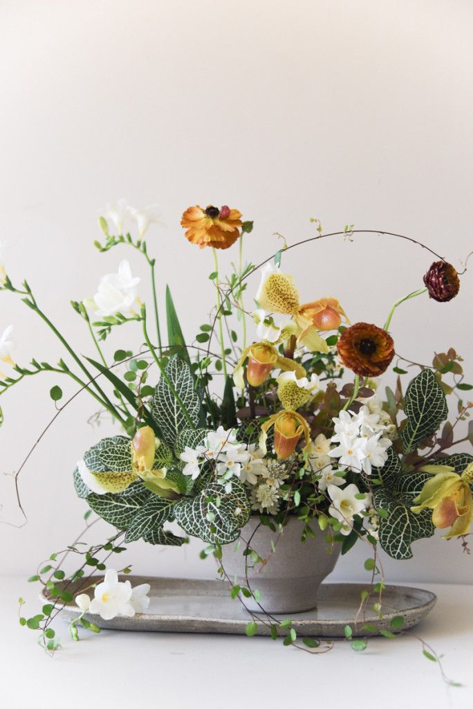 yellow, orange, white and green flower arrangement by Sarah Winward