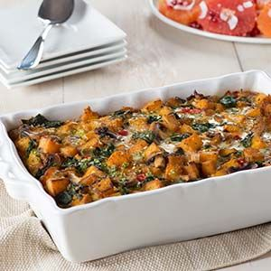 Spiced with thyme, garlic and paprika, this flavorful casserole featuring butternut squash, red peppers and spinach is perfect for holiday entertaining.