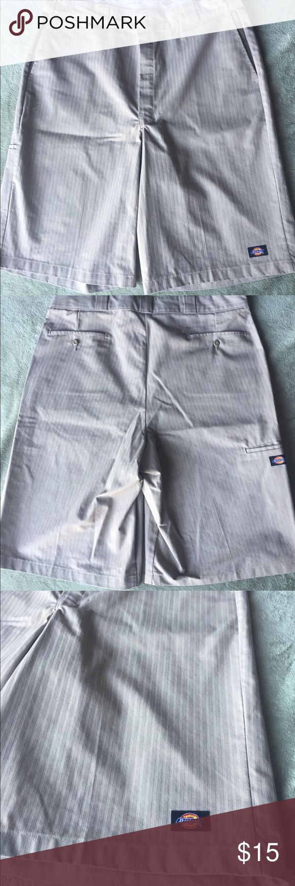 Men's size 38, pinstriped khaki Dickies shorts! Men's size 38, loose fit, pinstriped khaki Dickies shorts! Please see all photos!!! These shorts are practically brand new! They would be in perfect condition if it wasn't for the little tiny spot (shown in last photo). You really can't notice it unless you are staring right at the fly.... lol. Also has cell phone pocket! Dickies Shorts Flat Front
