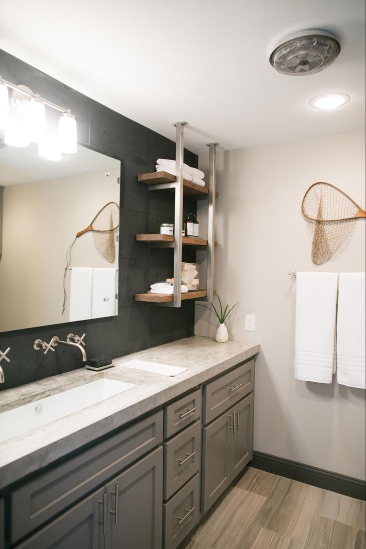 Concrete countertops, Black slate backsplash, Gray lower cabinets w/modern pulls and hardware...and  dark gray stoned-in shower