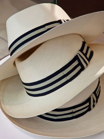 Panama hats...very nice striped band. Cool beans.