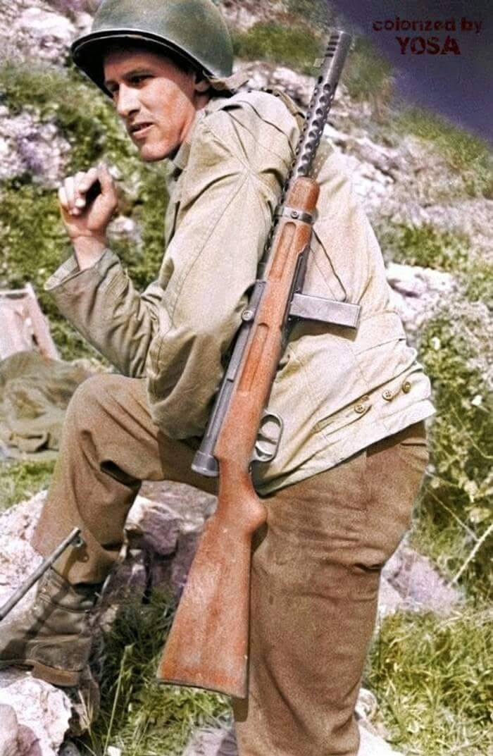 eaa242a2b Soldier of the US Army 10th Mountain Division with a captured Beretta M38  submachine gun during the the advance through Italy in the later part of  1944.