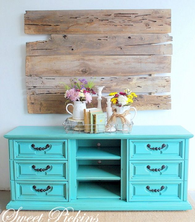An old style 9 drawer dresser is updated into a trendy side console by removing the middle three drawers for open shelving. A bright turquoise paint brings it into the modern era.