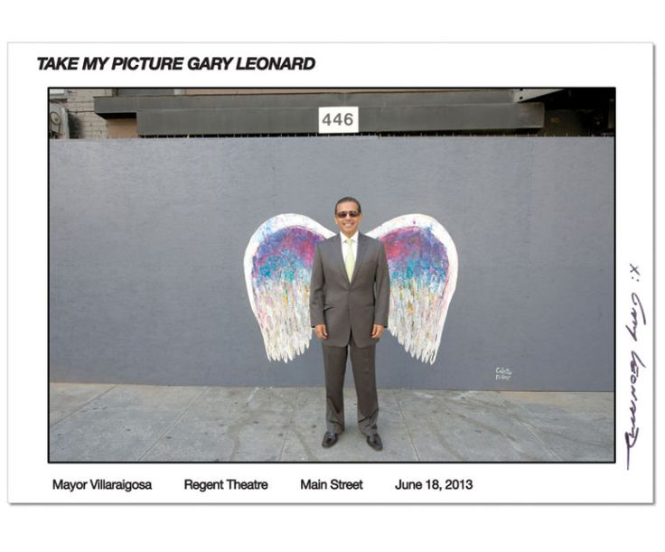 June 18, 2013: Mayor Villaraigosa in front of Regent Theatre, Main Street in DTLA. Angel Wings painting by Colette Miller