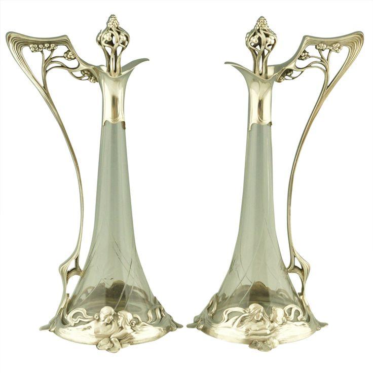 A pair of art nouveau claret jugs with ladies by WMF.