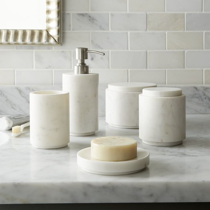 Cool, classic marble beautifies the bath in modern, straight-line shapes. Made of a natural material, each piece will vary slightly in tone and markings. P