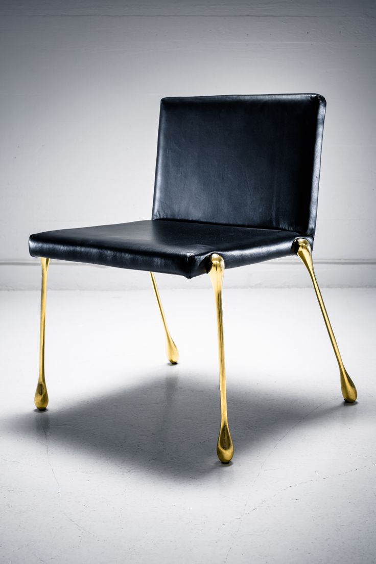 Sira is a black leather chair with solid brass feet. The chair is a part of a bespoke collection of furniture designed for Hanasaari Cultural Center.  The leather is Italian, and extremely high quality. The formally fluid legs are made from solid, cast brass, using 3D printed wax as formwork. The chair is made by hand in India. The chairs are available for sale at eboutique.sotamaa.net