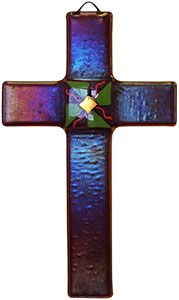 Show your love with this fused glass cross!  The dramatic visuals are created as light plays through the varying glass materials, which are fused together in a high-temperature, ceramic kiln. The center ornaments are made of dichroic glass containing metal oxides, the top layer is iridescent glass for the chameleon effect, and the main body is translucent glass with a different colored edge. As seen in the additional image above, the cross is especially stunning in direct light, so be sure…