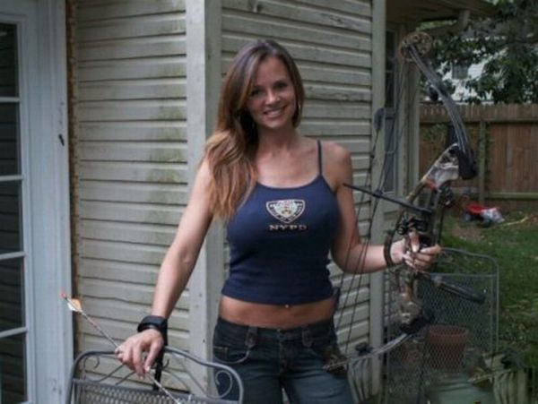 Busty girl shooting bow