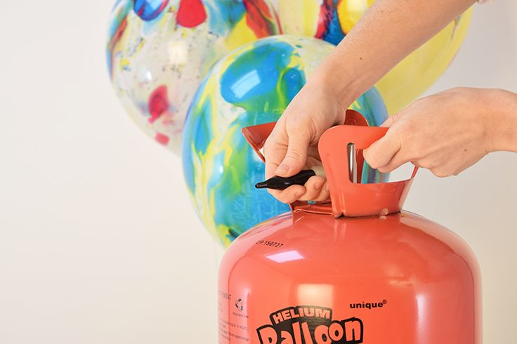 How to inflate a balloon using a helium canister