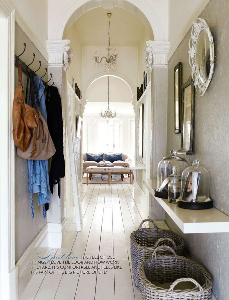 White painted floors. Entryway & Hallway by Amanda Henderson Marks    ---    Narrow hallway, bench on one side, mirror above bench, hooks for coats across from bench.