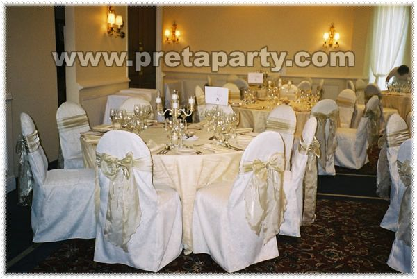 White satin chair covers with sash bow