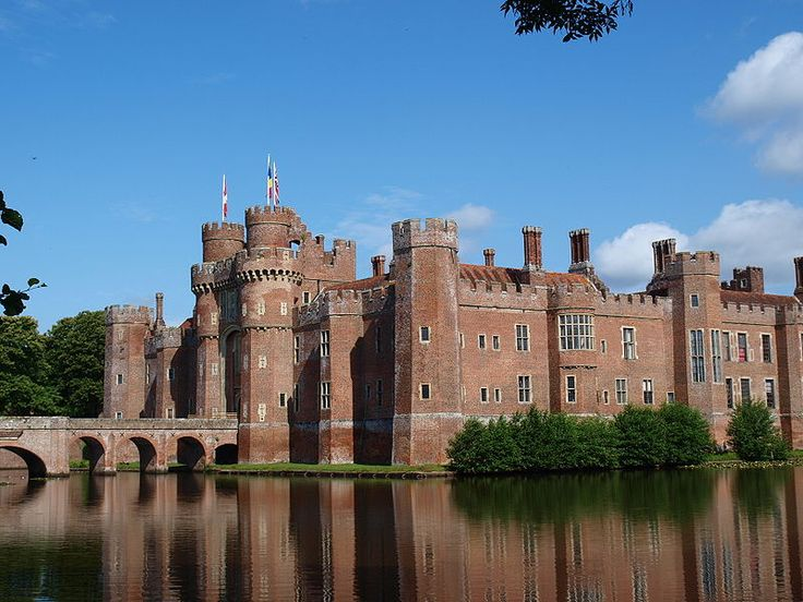 Herstmonceux Castle is a brick-built Tudor castle near Herstmonceux, East Sussex, England. From 1957 to 1988 its grounds were the home of the Royal Greenwich Observatory