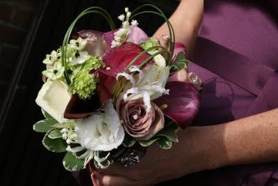Amnesia Roses, White Lysianthus, Ornithogalum, Curled Grasses and Deep Purple Mini Lilies Bridesmaid Posy   Contact Nicci Snook Flowers - Specialist in Traditional and Vintage Weddding Flowers on 07739313551. www.facebook.com/niccisnookflowers