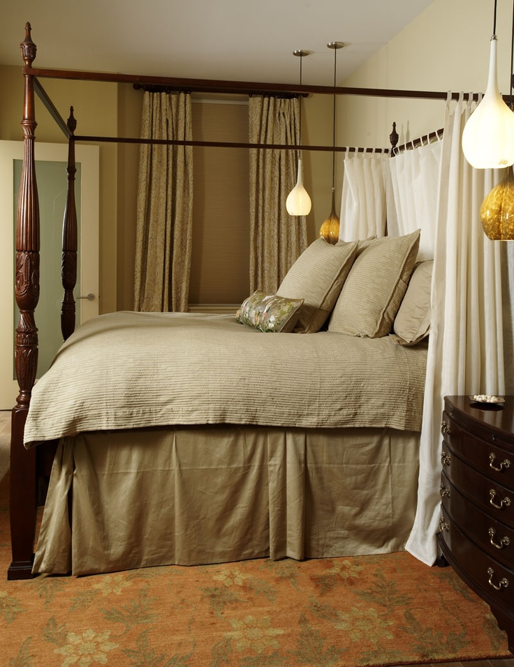 Antique bed frame spotlights the boosted bed. Ceiling